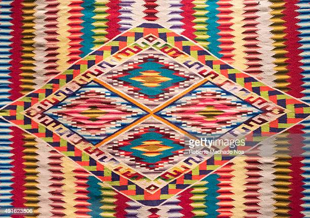 Full frame shot of Mexican native art pattern on a cloth The art has vertical zigzag color patterns with four squares in the center The Textiles of...