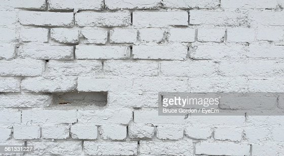 Full Frame Shot Of Missing Brick In Whitewashed Wall