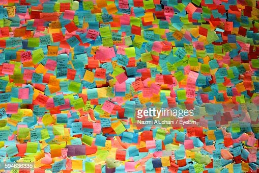 Full Frame Shot Of Multi Colored Adhesive Notes On Wall