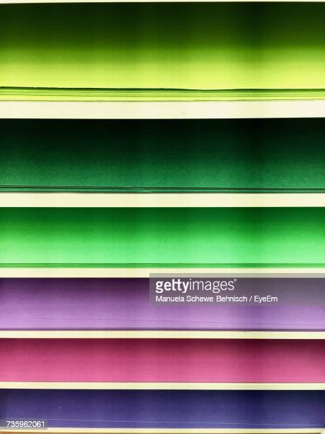 Full Frame Shot Of Multi Colored Papers Arranged On Shelves