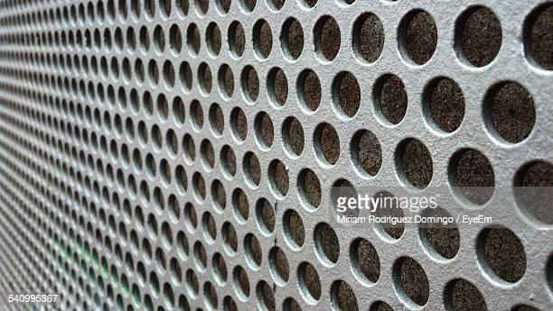 Full Frame Shot Of Patterned Metal Wall
