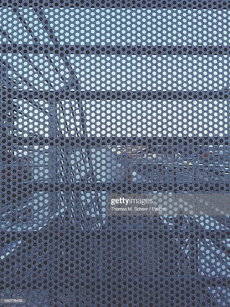 Full Frame Shot Of Perforated Metal Grate