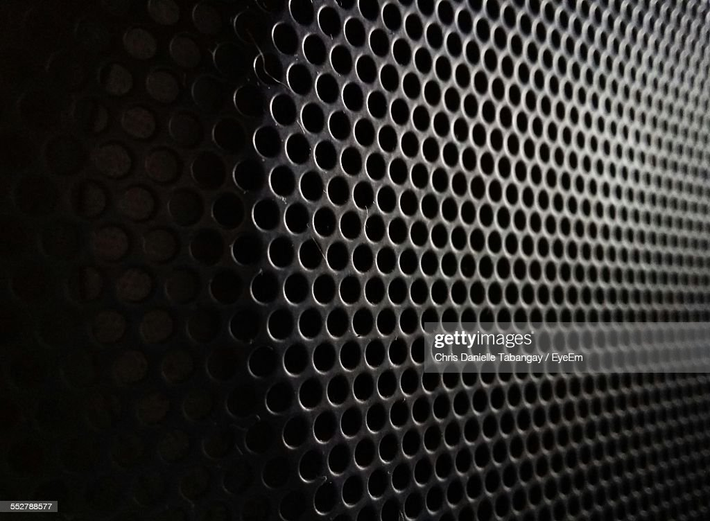 Full Frame Shot Of Perforated Metal : Stock Photo