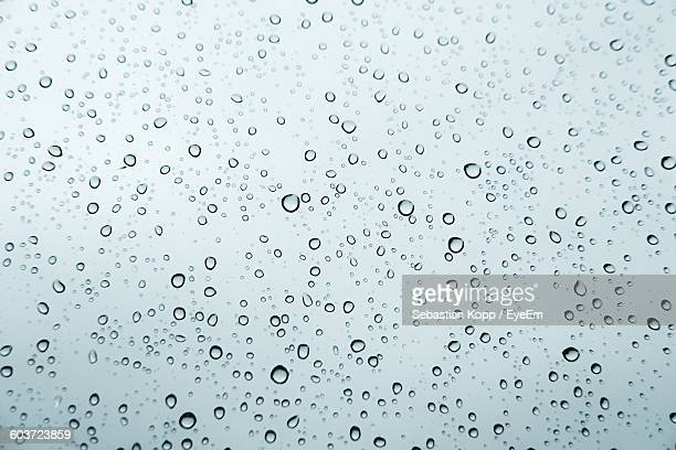 Full Frame Shot Of Raindrops On Glass