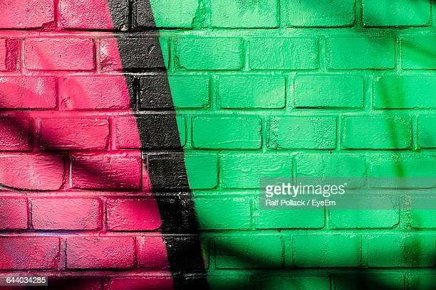 Full Frame Shot Of Red And Green Brick Wall