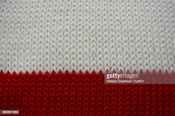 Full Frame Shot Of Red And White Sweater