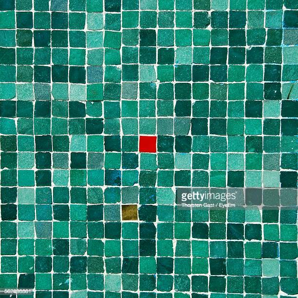 Full Frame Shot Of Red Mosaic Amidst Turquoise Colored