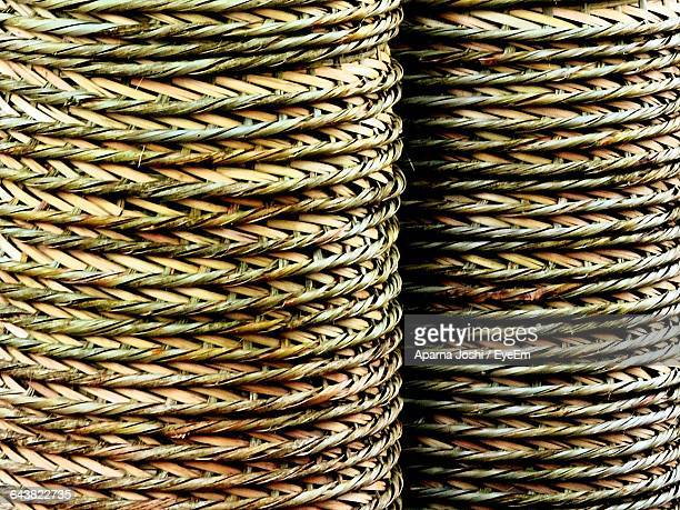 Full Frame Shot Of Stacked Whicker Baskets