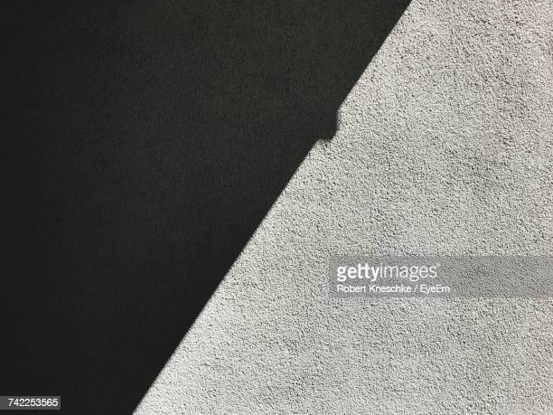 Full Frame Shot Of Textured Wall With Shadow