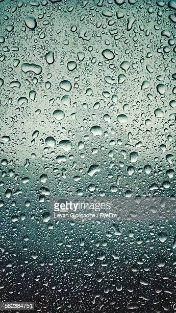 Full Frame Shot Of Wet Glass In Rainy Season