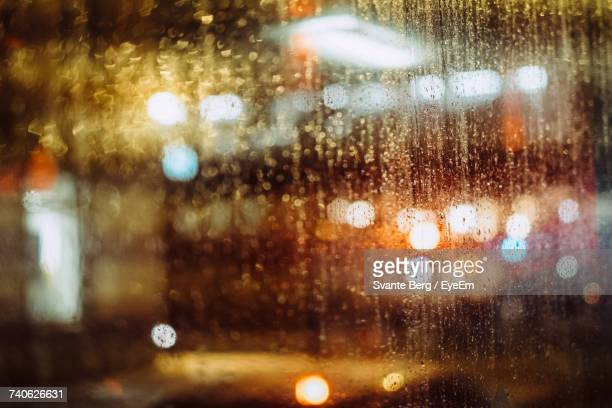 Full Frame Shot Of Wet Window Glass At Night