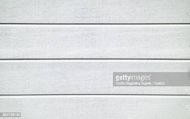 Full Frame Shot Of White Garage Wooden Door