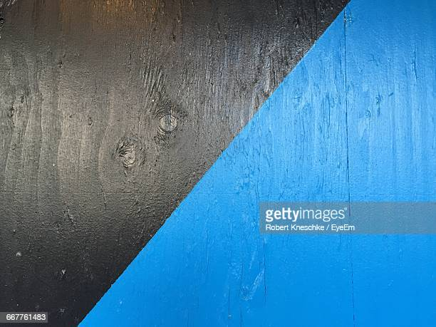 Full Frame Shot Of Wooden Plank Painted In Blue And Black