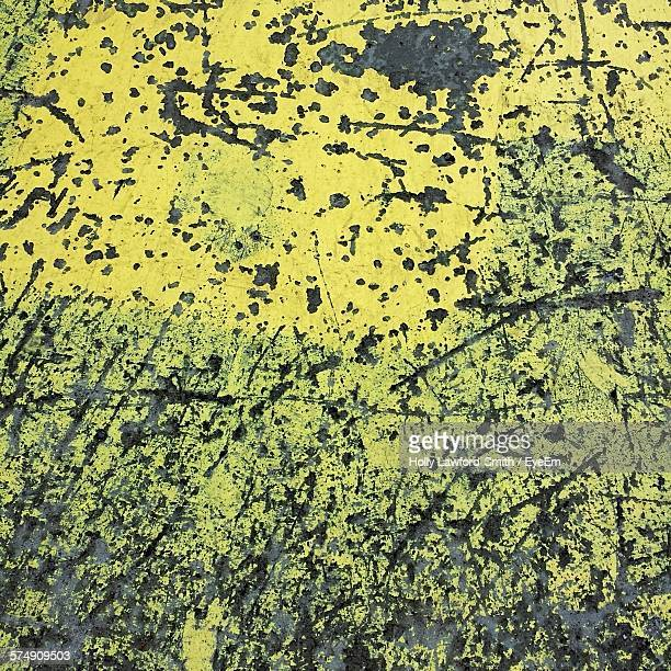 Full Frame Shot Of Yellow Peeling Paint On Wall