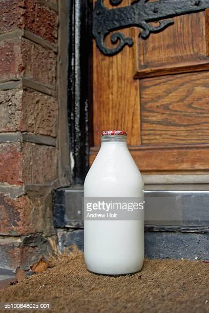 Full glass bottle of milk on doorstep