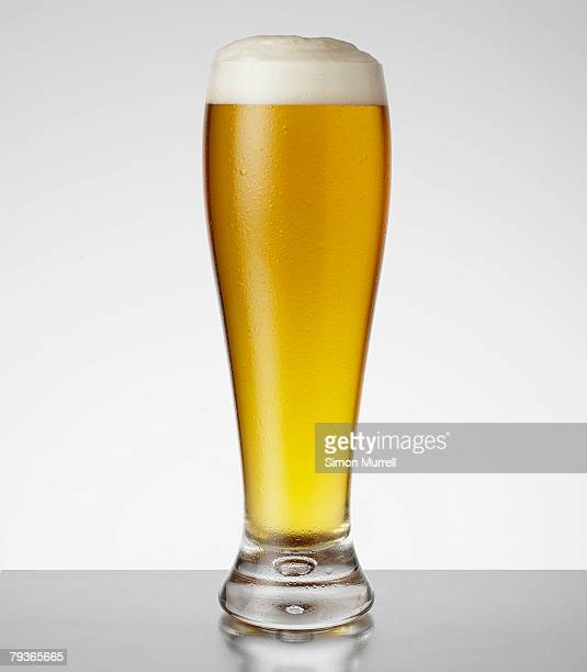 Full glass of beer indoors