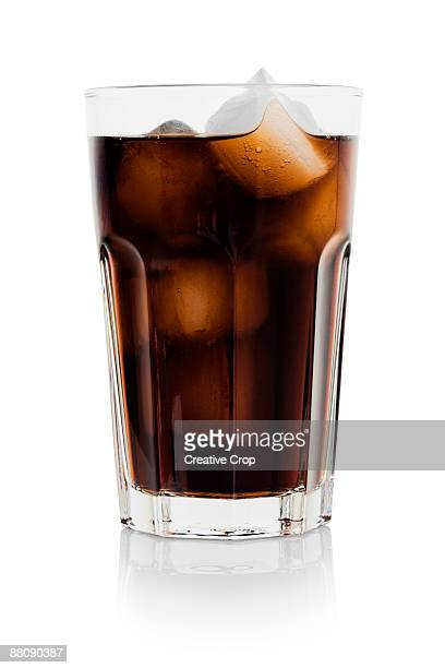 Full glass of cola and ice cubes