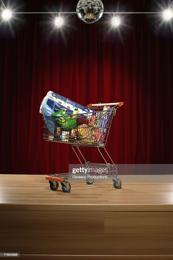 Full grocery cart on stage : Stock Photo