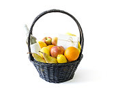 Real and normal look of basket with fruit isolated on white background with shadow, knitted black basket