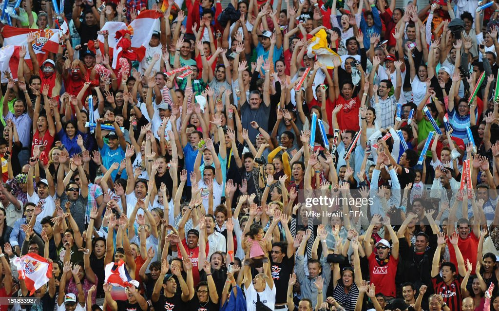 A full house does the Mexican wave during the FIFA Beach Soccer World Cup Tahiti 2013 Quarter Final match between Argentina and Tahiti at the Tahua To'ata Stadium on September 25, 2013 in Papeete, French Polynesia.