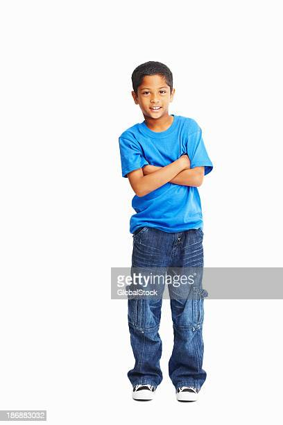 Full length of a casual boy with hands folded