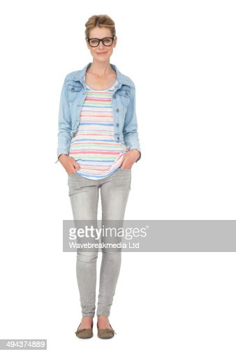 Full length of a casually dressed young woman : Stock Photo