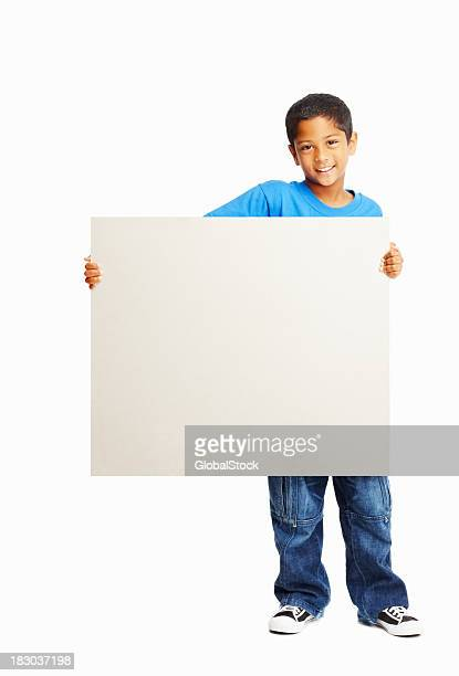 Full length of a kid with blank board - copyspace