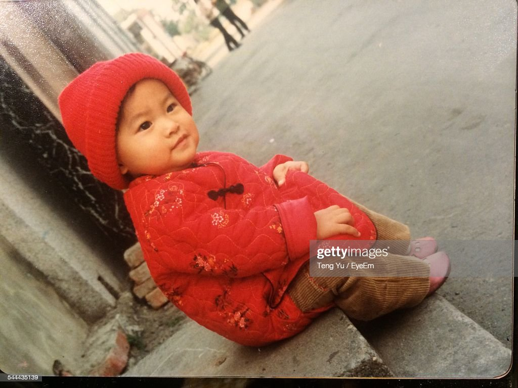 Full Length Of Baby Sitting On Steps By Street