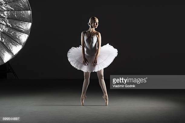 Full length of ballerina performing at studio