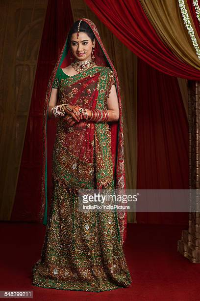 Full length of beautiful young bride standing