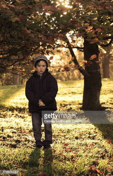 Full Length Of Boy Standing On Field During Autumn