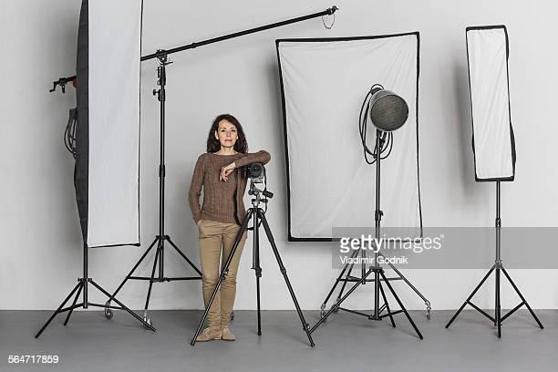 Full length of confident mature female photographer in photo studio