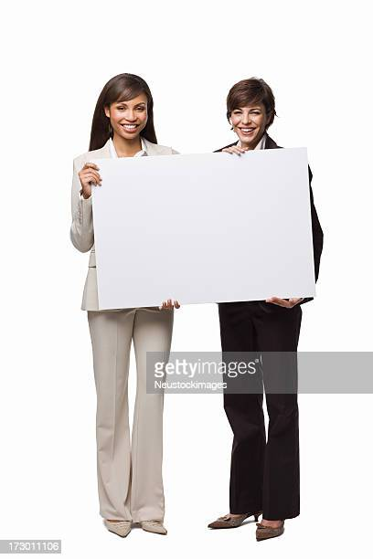 Full length of happy business colleagues holding blank card