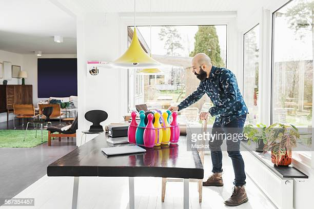 Full length of male architect standing at table in home office