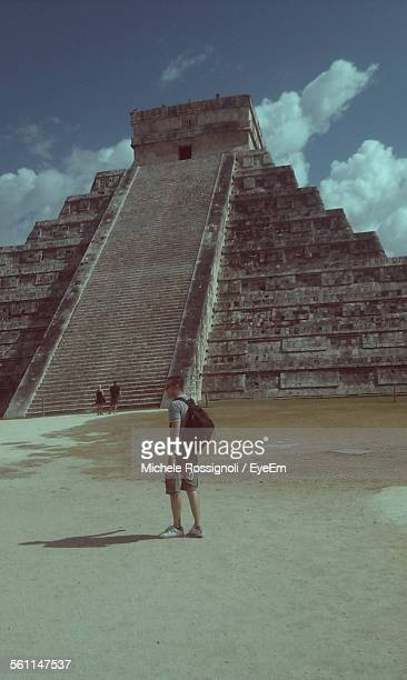 Full Length Of Man In Front Of Chichen Itza Against Sky