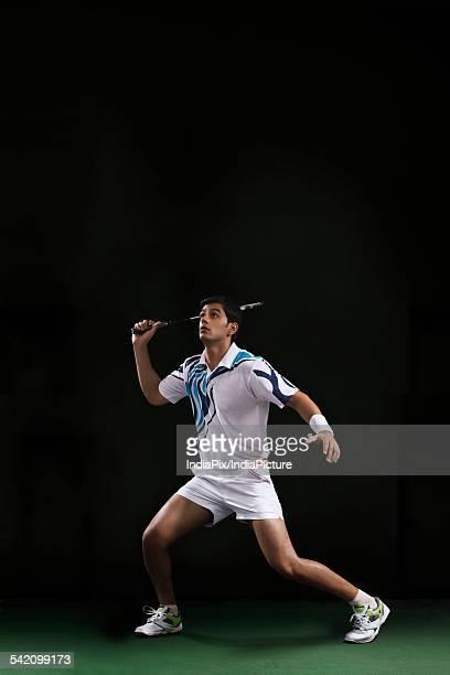 Full length of man playing badminton at court