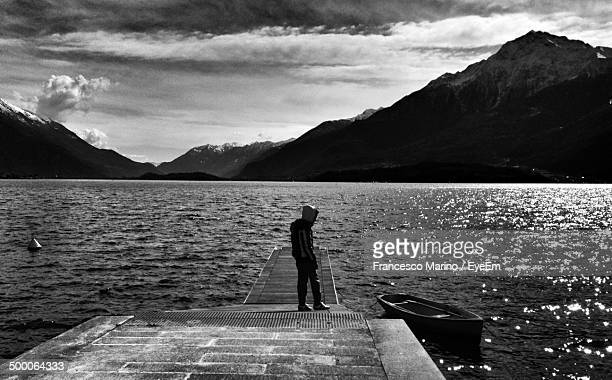 Full length of man standing on pier at sea
