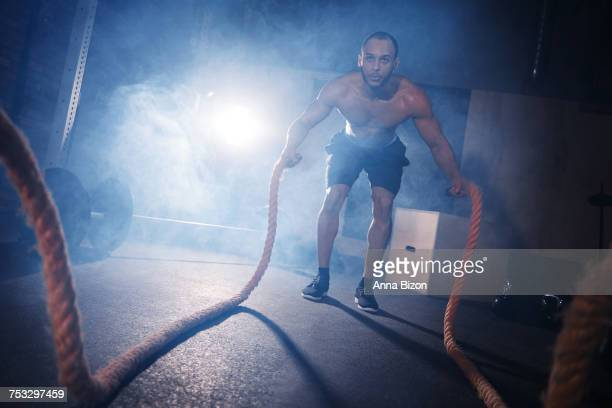 Full length of man tossing gym ropes. Mielec, Poland