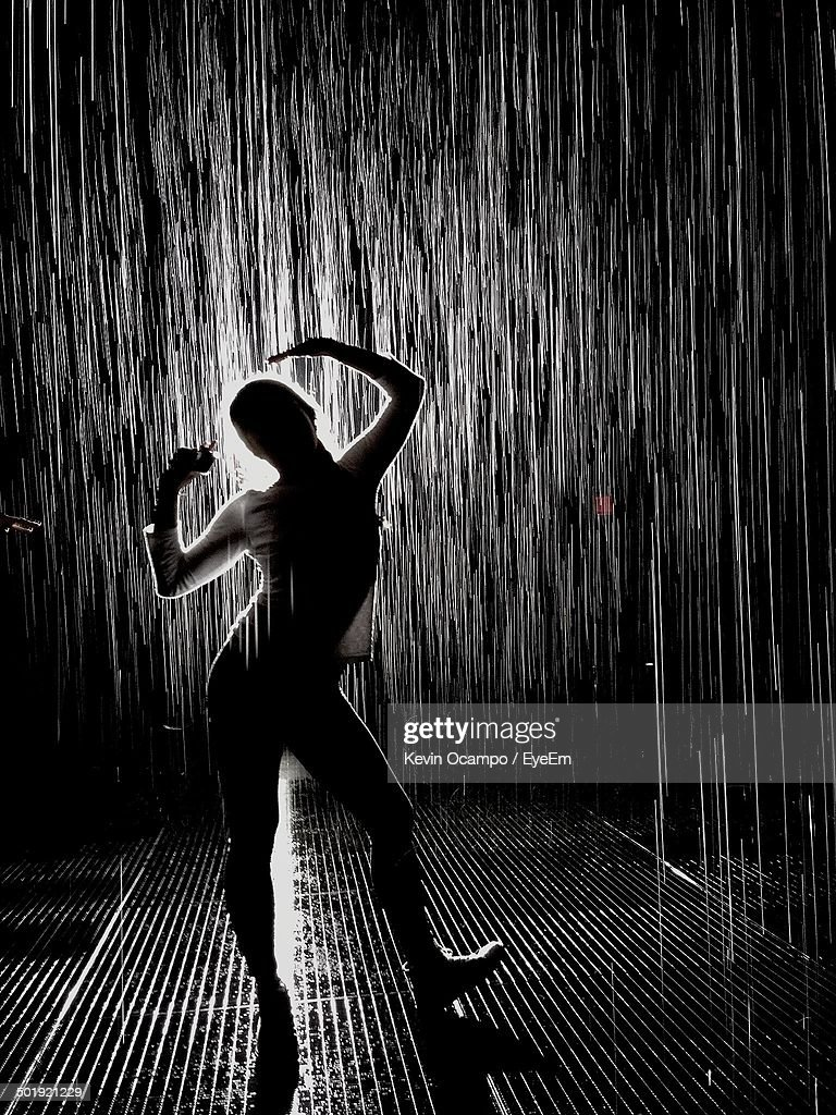 Full Length Of Silhouette Woman Dancing In Rain Stock ...