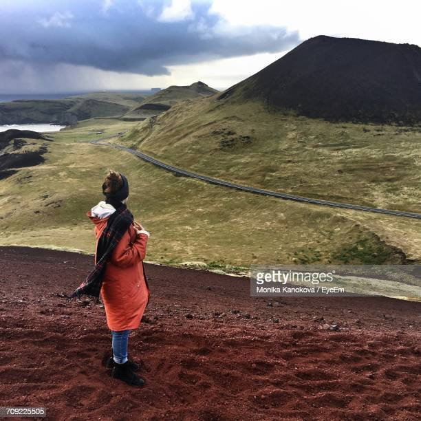 Full Length Of Woman At Vestmannaeyjar Looking At Mountain