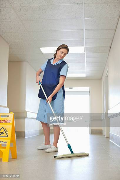 Full length of woman cleaning hospital floor