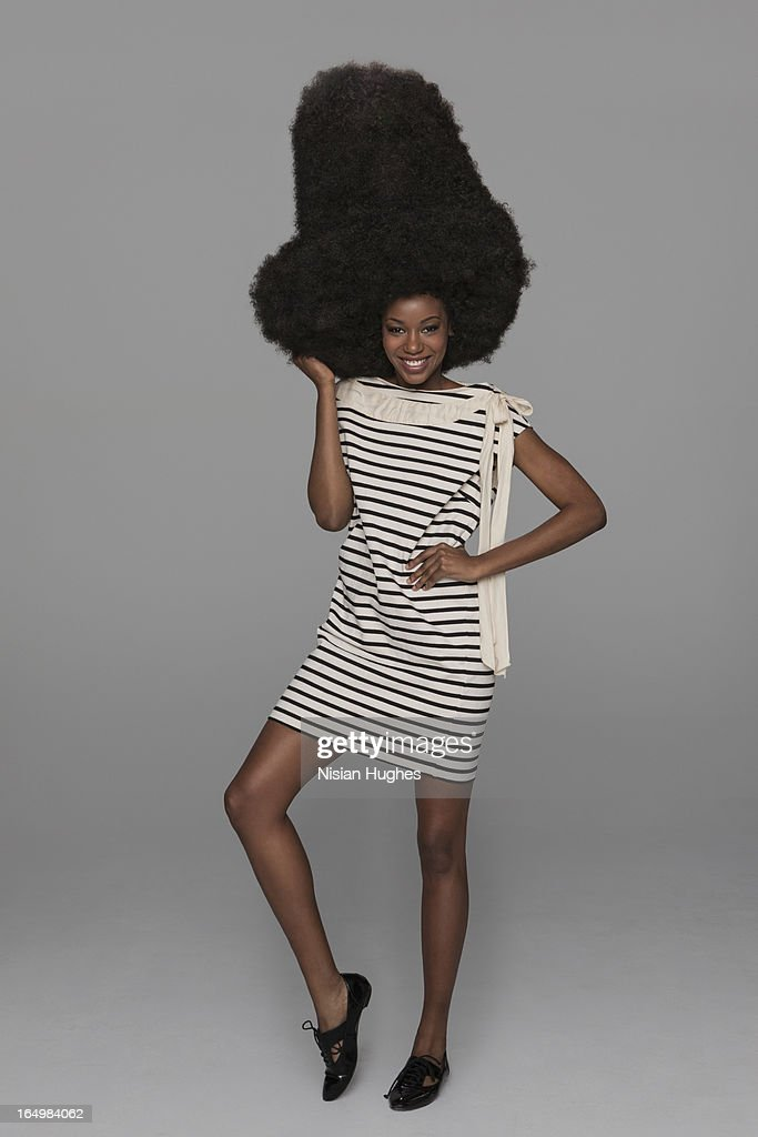 Full length of woman with very large afro