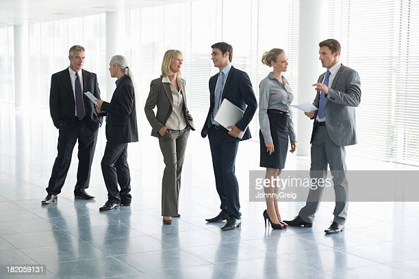 Full length picture of business people in conversation