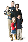 full length portrait of an attractive family of parents and three children