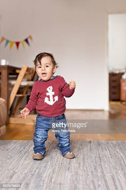 Full length portrait of baby boy looking at camera