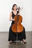 Full length portrait of cello player