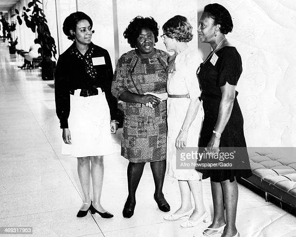 A full length portrait of civil rights leader Fannie Lou Harmer with Christine Moore Janine [] and Ruby Gill 1969