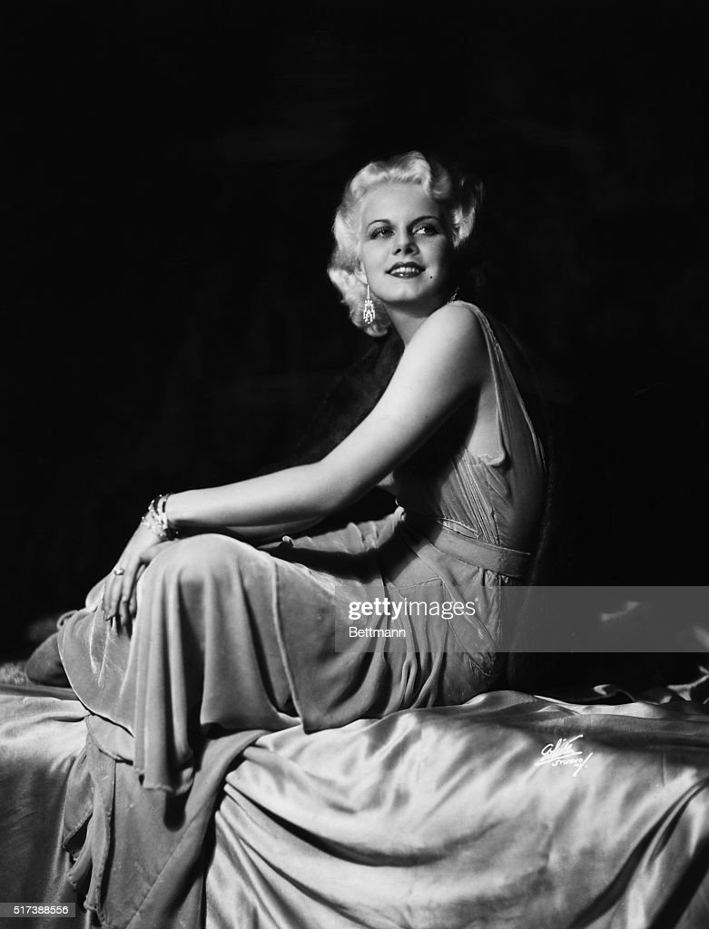 Full length portrait of <a gi-track='captionPersonalityLinkClicked' href=/galleries/search?phrase=Jean+Harlow&family=editorial&specificpeople=70012 ng-click='$event.stopPropagation()'>Jean Harlow</a> seated wearing velvet dress. Undated photograph.
