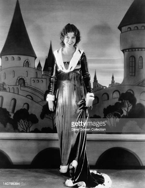 Full length portrait of Jeanette MacDonald US singer and actress wearing a full length dress erminetrimmed dress against a background of a painted...
