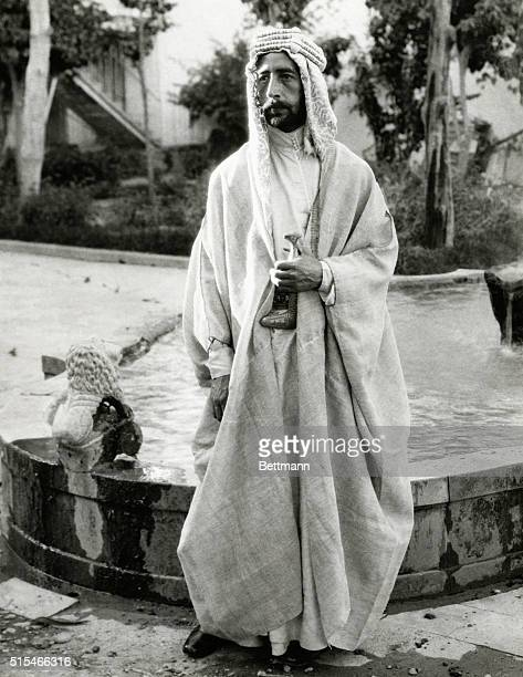 Full length portrait of King Faisal I of Iraq whose country is now protected from onslaughts by fanatic Wahabi Tribesmen under Ibn Saud Undatd...